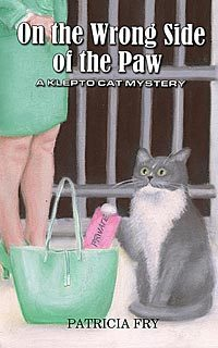 On the Wrong Side of the Paw: A Klepto Cat Mystery
